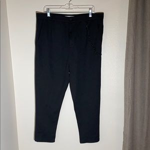 Men's cropped trousers with chain
